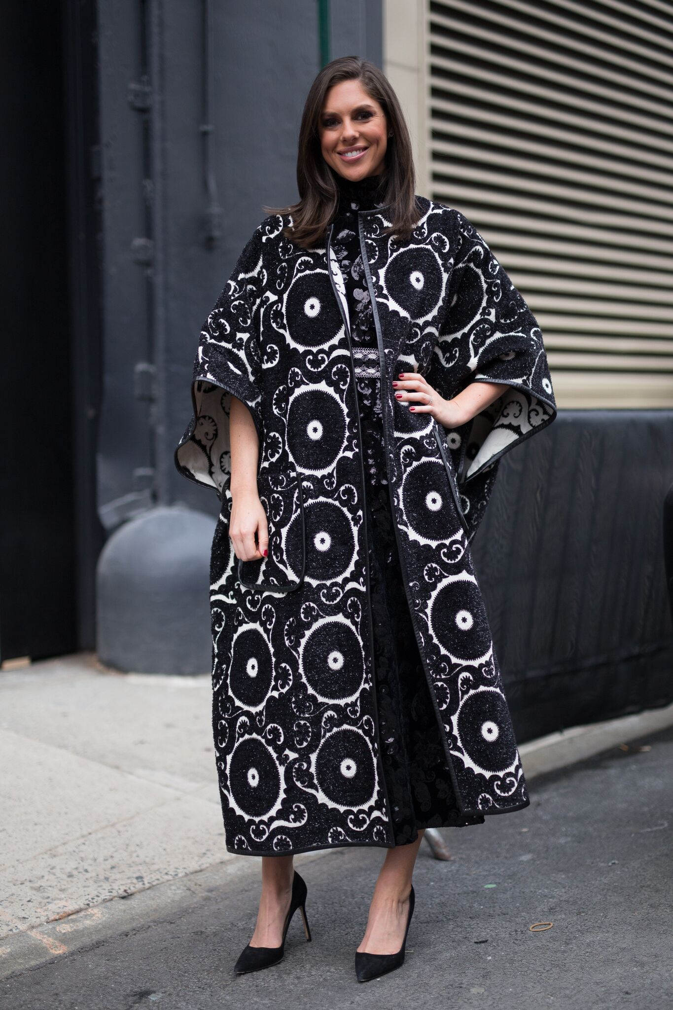 Abby Huntsman is seen attending Vivienne Tam during New York Fashion Week while wearing black and white circle design coat | Getty Images