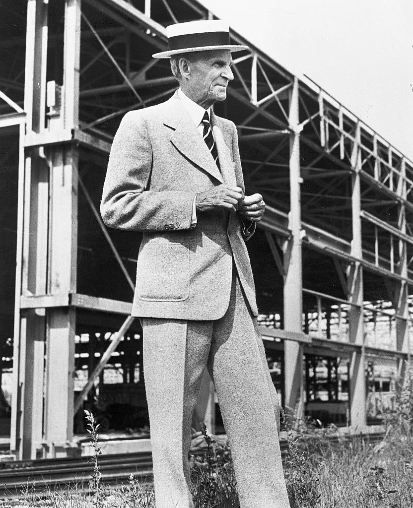 Henry Ford posing in front of scaffolding during the construction of a Ford Motors aircraft factory in Willow Run, Michigan | Photo: Getty Images