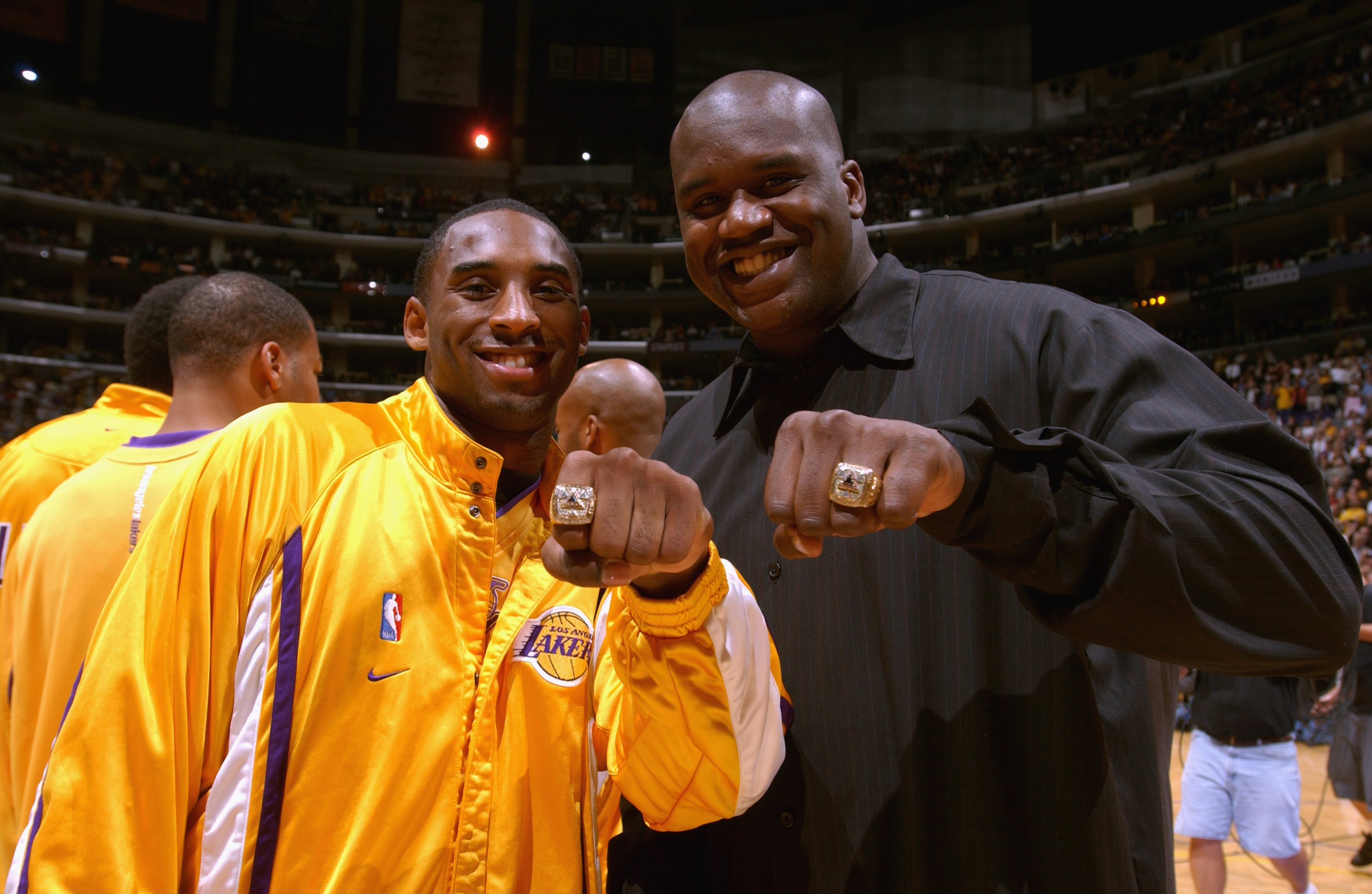 Kobe Bryant and Shaquille O'Neal showing their rings at Staples Center on October 29, 2002 in Los Angeles, California. | Source: Getty Images
