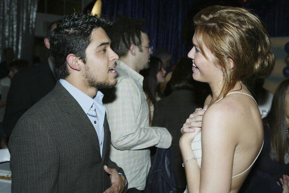 """Actors Wilmer Valderrama and Mandy Moore talk at the after-party for United Artists' """"Saved"""" at the Beverly Hills Community Sports Center on May 13, 2004, in Beverly Hills, California. 