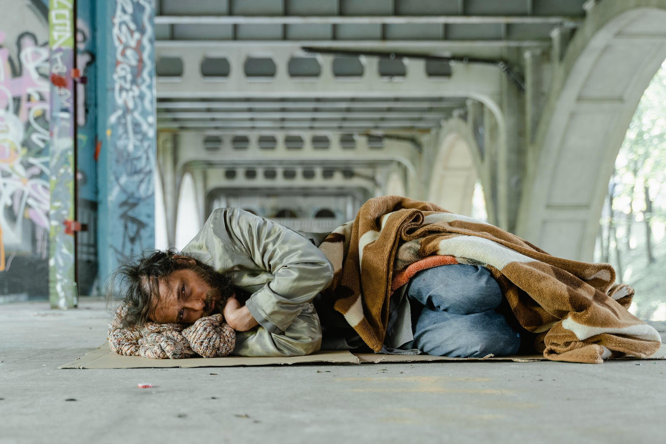 There was a homeless man sleeping under the bridge | Source: Pexels