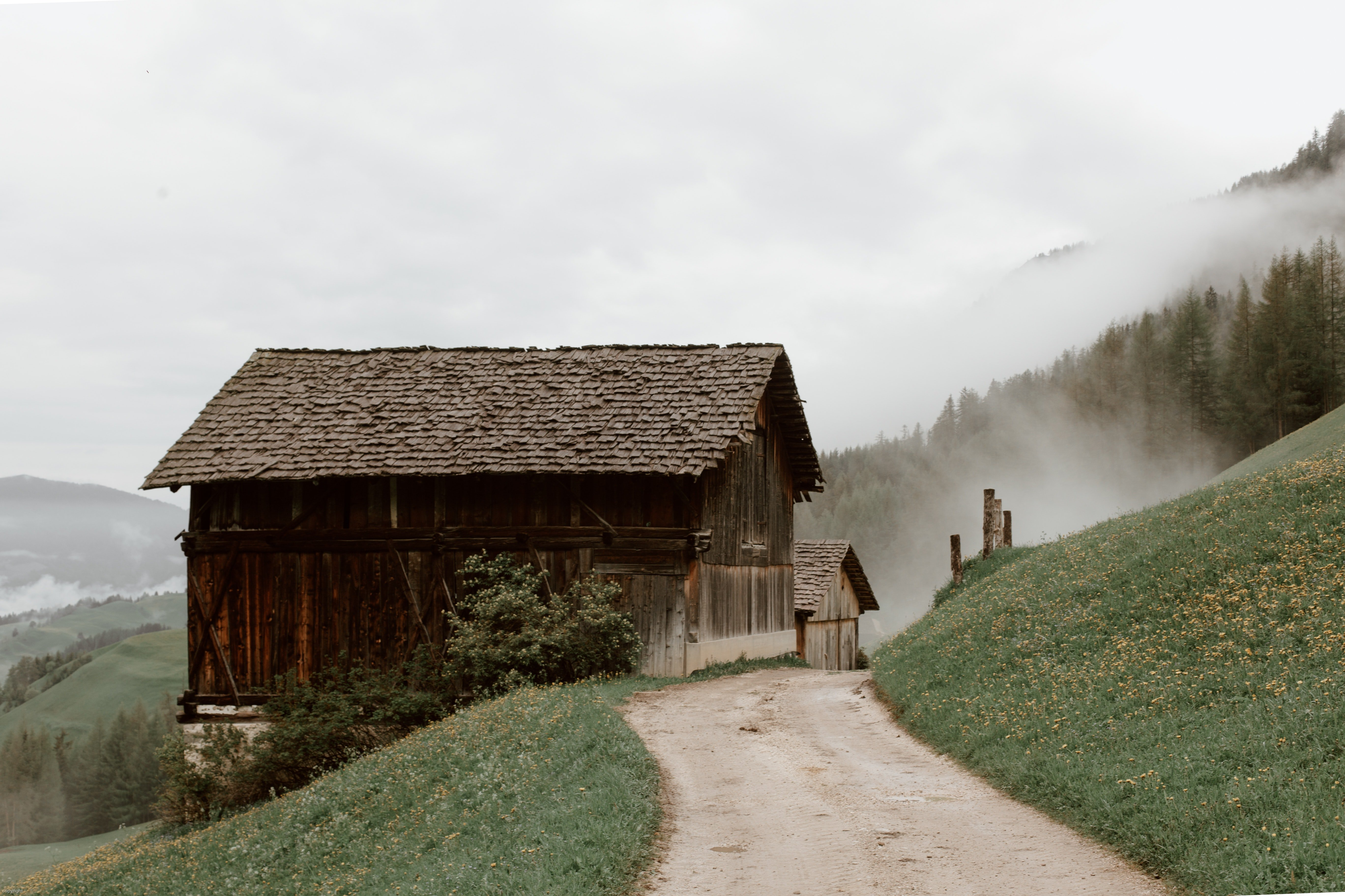 Pictured - A photo of rural houses on a slope   Source: Pexels