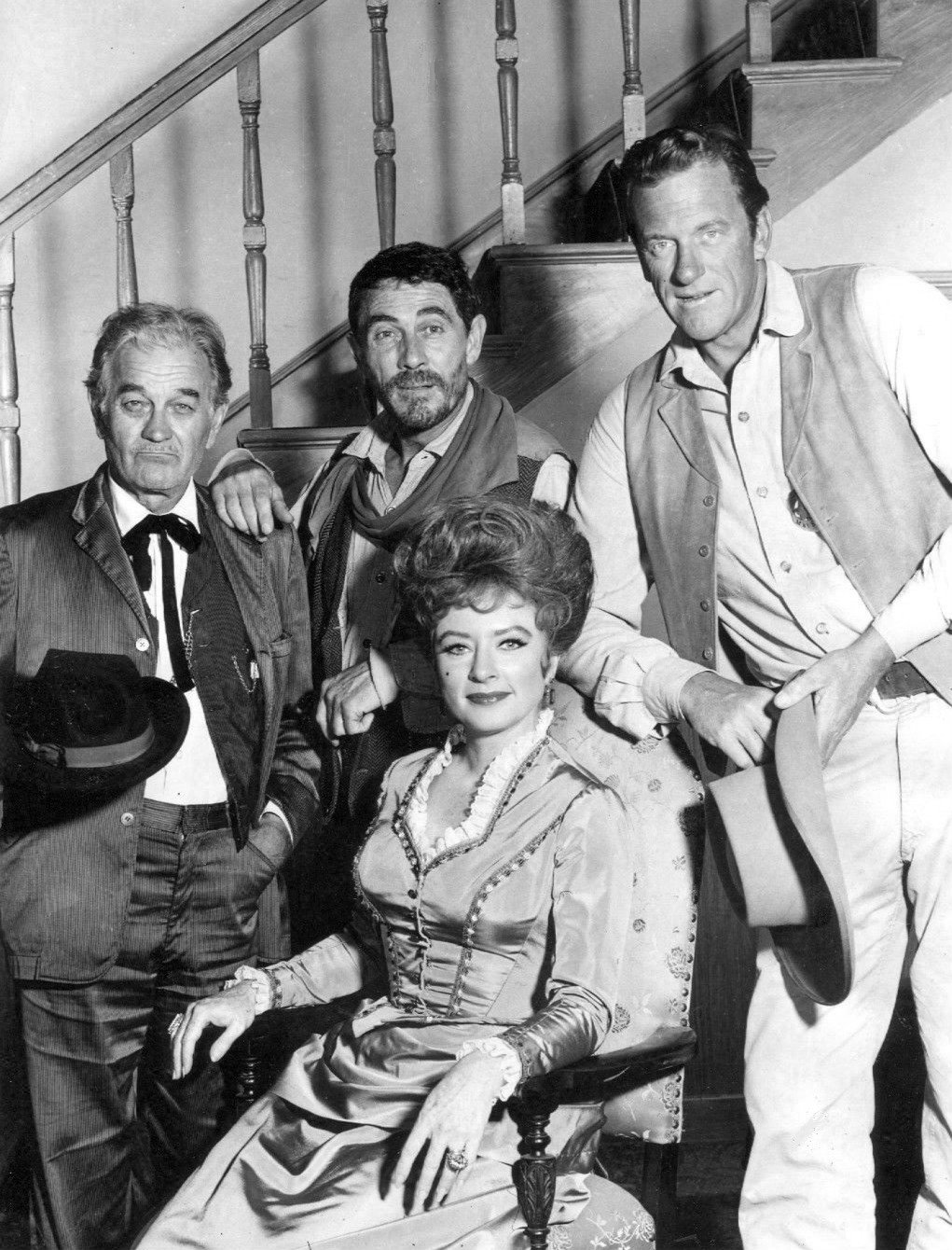 "James Arness as Marshall Matt Dillon, Ken Curtis as Festus Hagen, and Milburn Stone as ""Doc"" Adams. Seated: Amanda Blake as ""Miss Kitty"" Russell in ""Gunsmoke"" in 1967. 