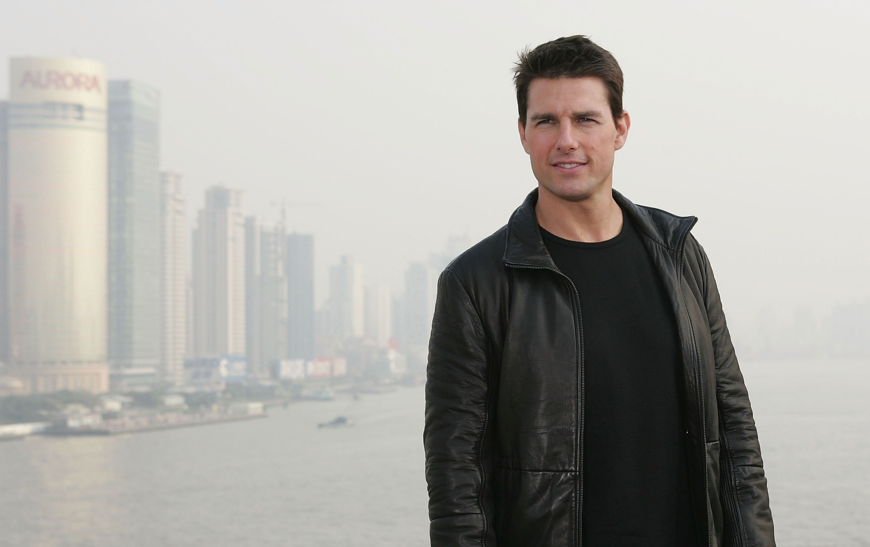 "Tom Cruise poses as he promotes ""Mission Impossible III"" on top Shanghai's historic Bund 18 building on November 30, 2005 in China. 