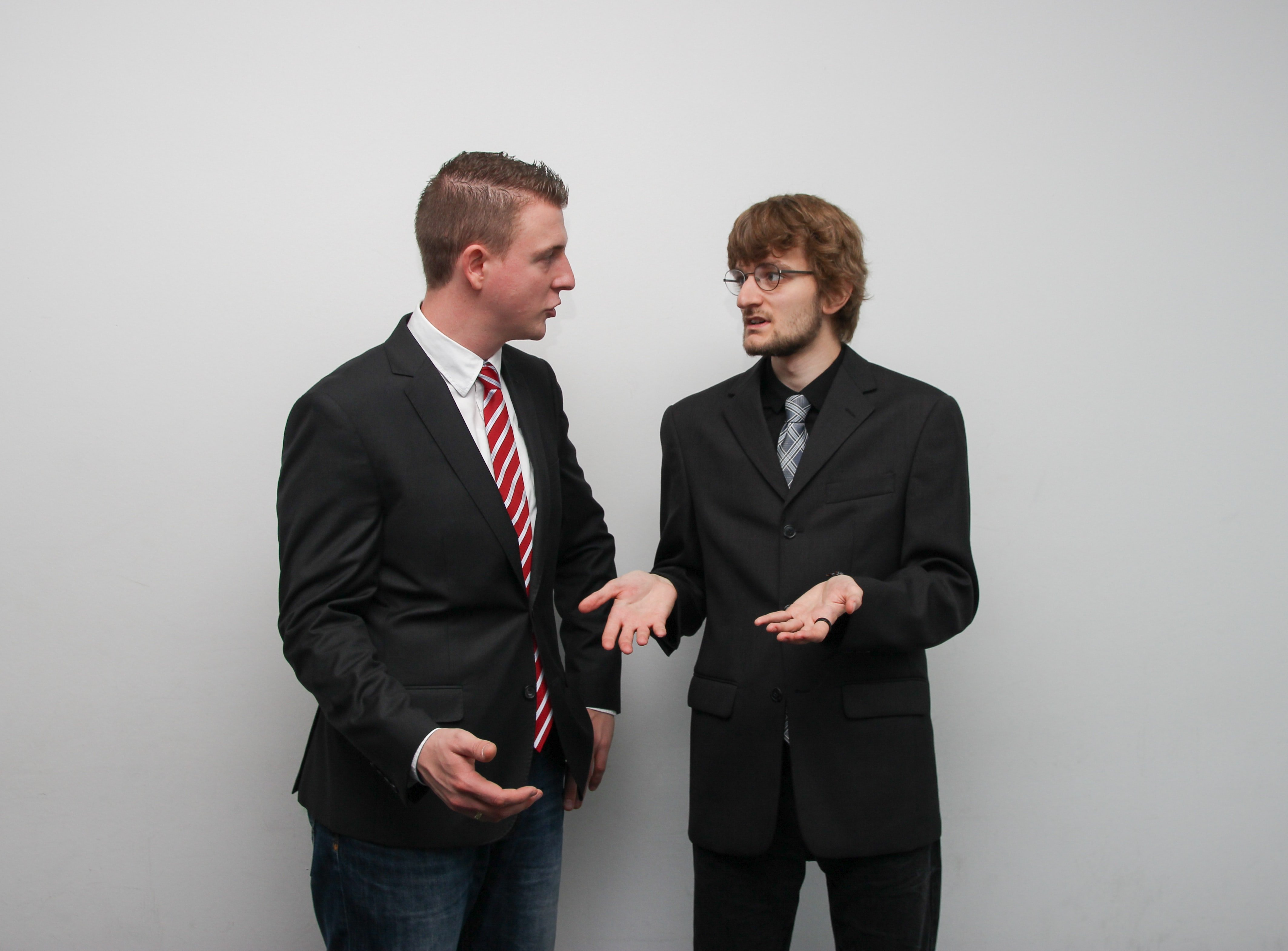 Two men involved in a heated argument | Photo: Unsplash