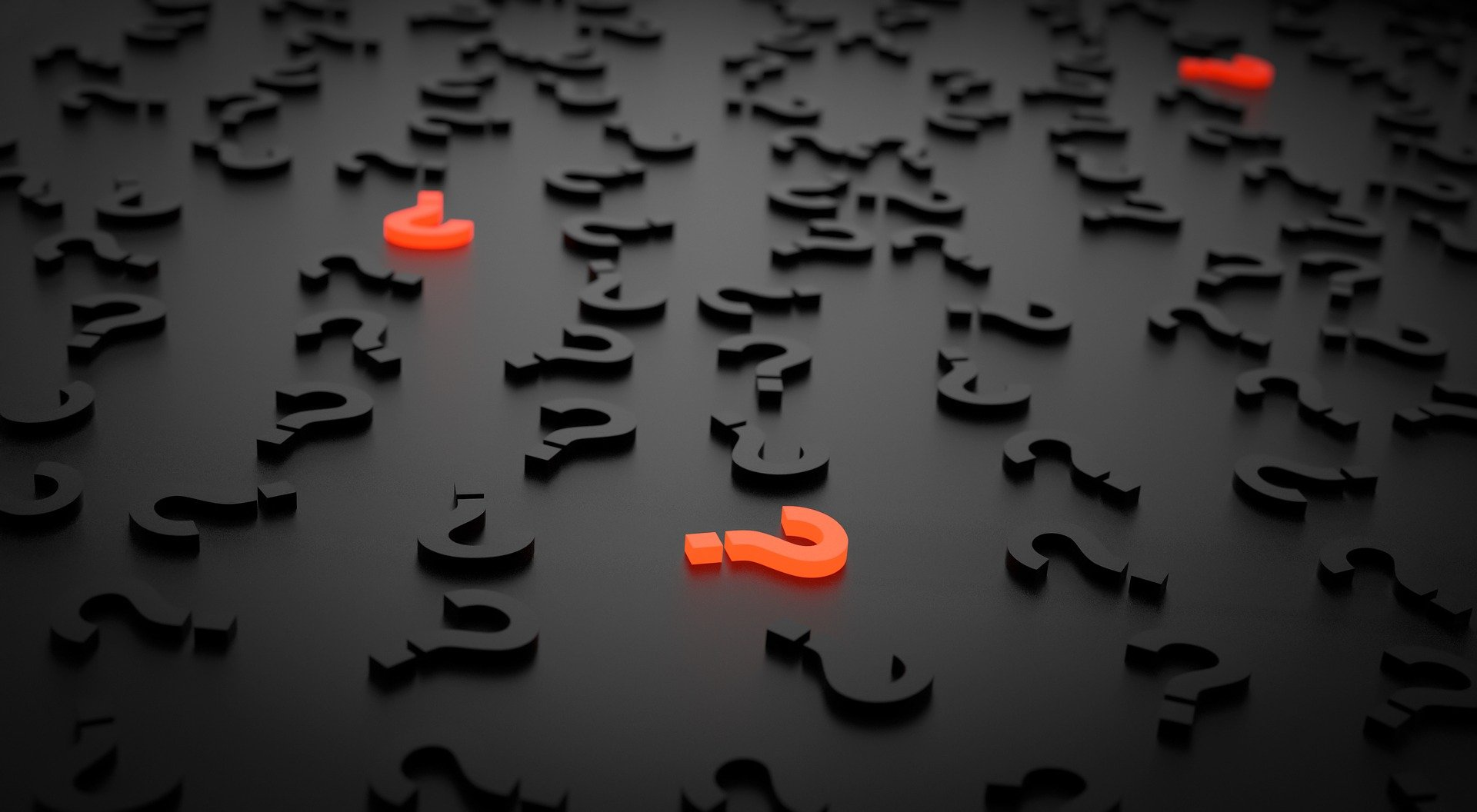 Black question marks are scattered with a few red questions in between.   Photo: Pixabay.com/Arek Socha