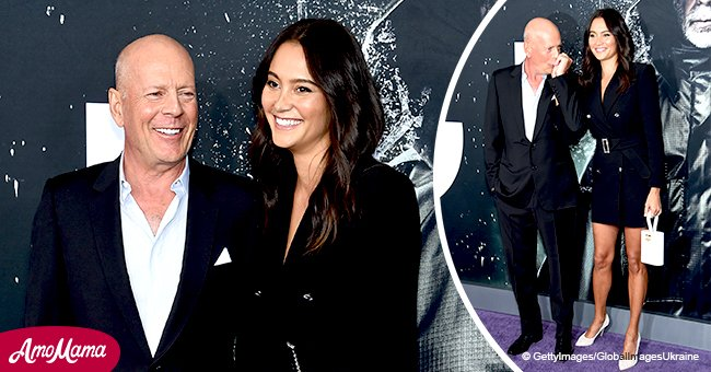Bruce Willis dons an elegant suit, kissing the hand of his wife who's 23 years younger than him