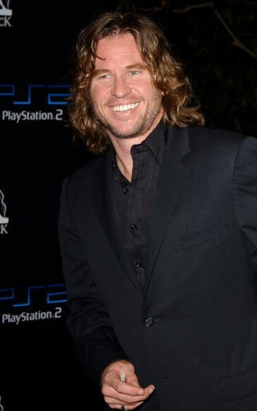 "Val Kilmer attends the Playstation 2 Party ""East Meets West In The Ultimate Battle Of The Gridiron,"" at a private residence on October 19, 2002, in Beverly Hills, California. 
