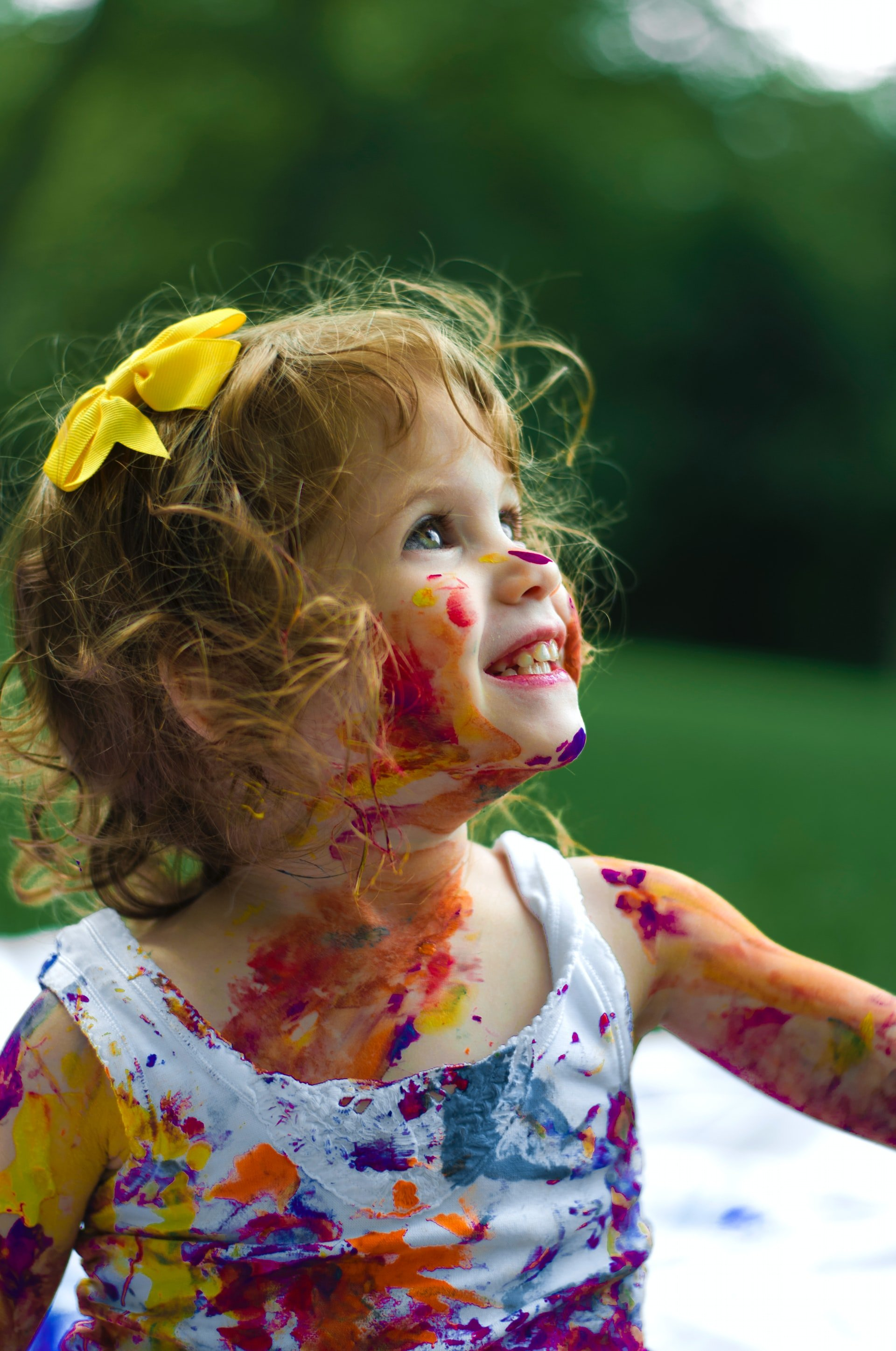 Little girl playing with paints   Source: Unsplash