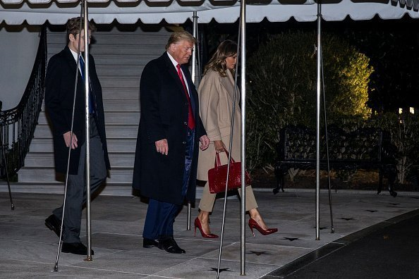 """resident Donald Trump leaves the White House before departing for Joint Base Andrews on December 20, 2019 in Washington, DC. President Trump will sign S.1790, the """"National Defense Authorization act for FY2020"""" at JBA before traveling to West Palm Beach, FL. Also pictured are First Lady Melania Trump and their son, Barron Trump 