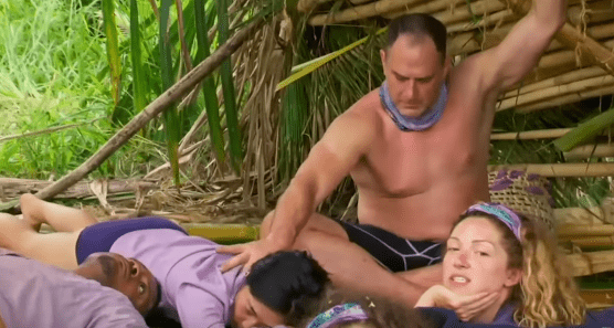 "Dan Spilo massaging Kellee Kim's neck while in camp on Season 39 of ""Survivor"" in 2019 