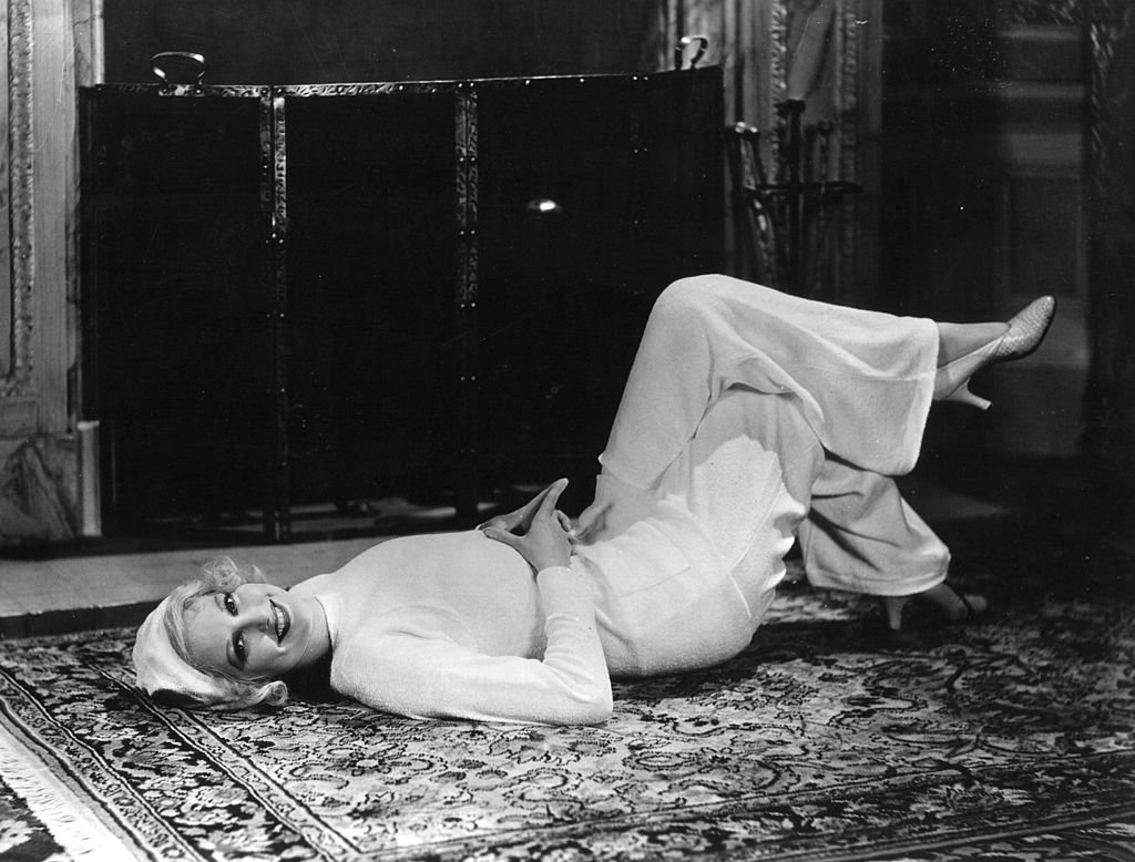 Thelma Todd ( 1905 - 1935 ) the perky heroine of many two-reel comedies lounging on the floor in front of a fireplace, demonstrating the very latest in lounging pyjamas circa 1931   Photo: Getty Images