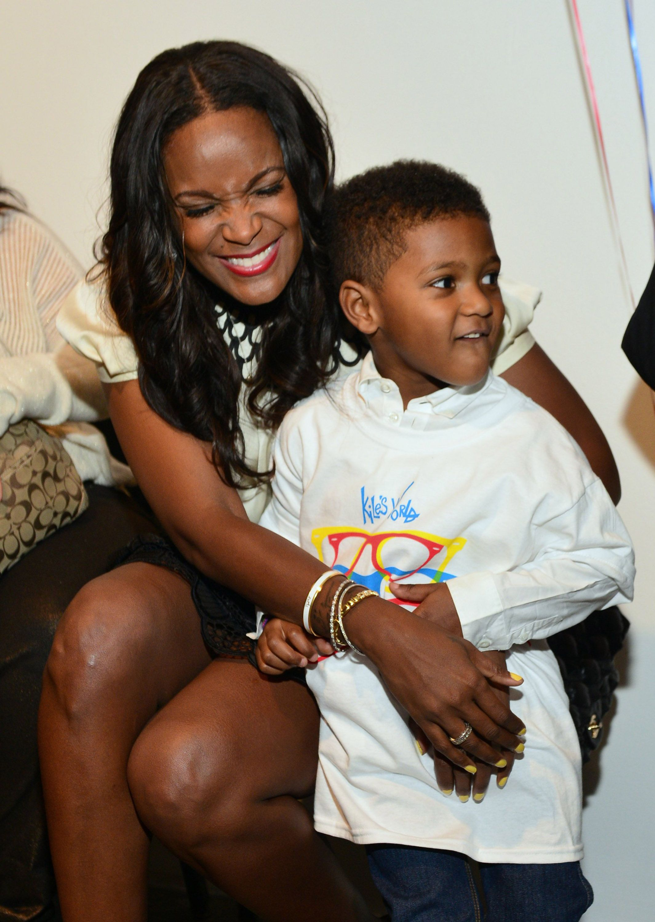 Tameka Foster and Naviyd Raymond during the birthday and foundation lanuch Kile's World to honor Kile Glover at the Woodruff Arts Center on March 29, 2013 in Atlanta, Georgia. | Source: Getty Images