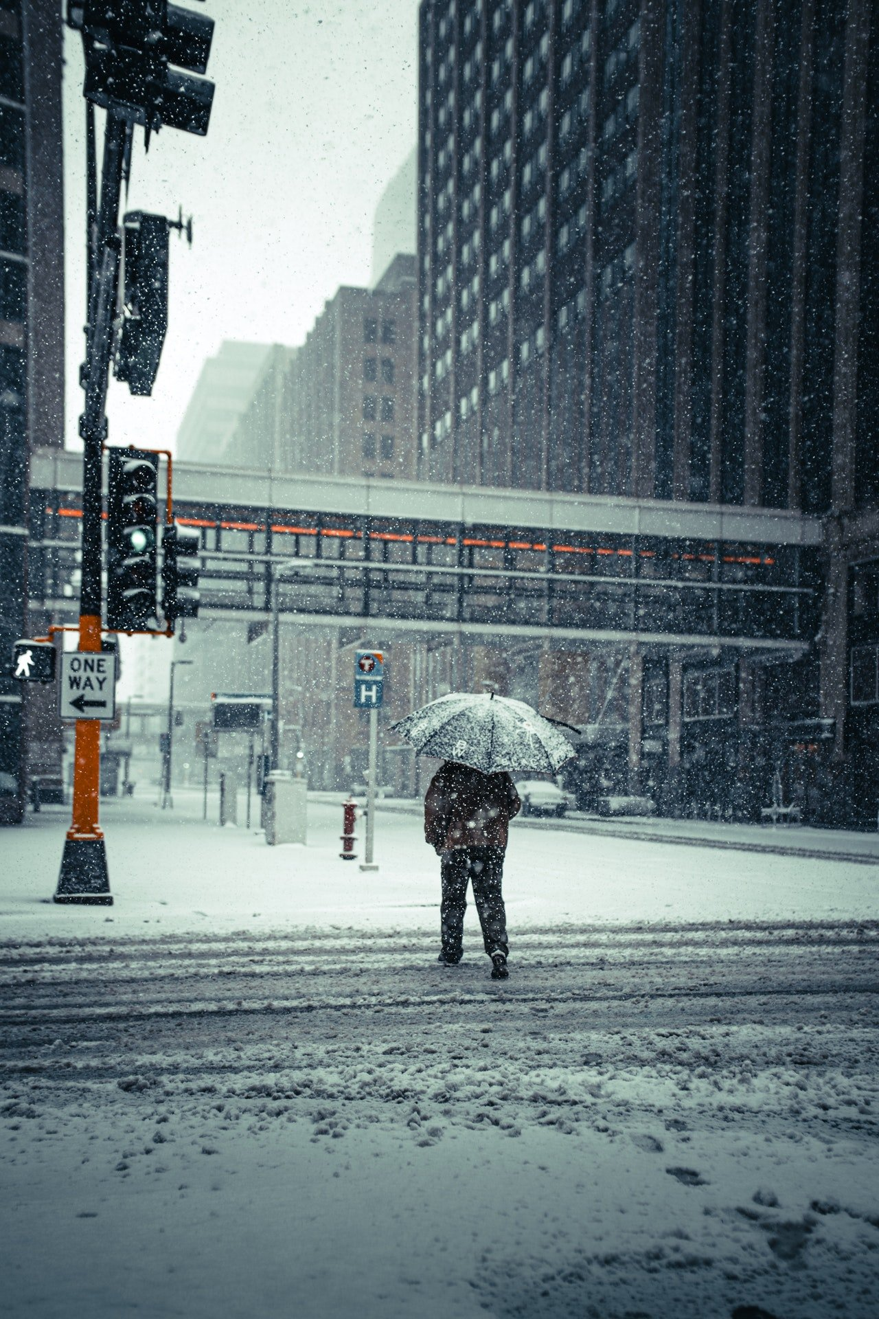 Photo of someone walking on a snowy street | Photo: Pexels