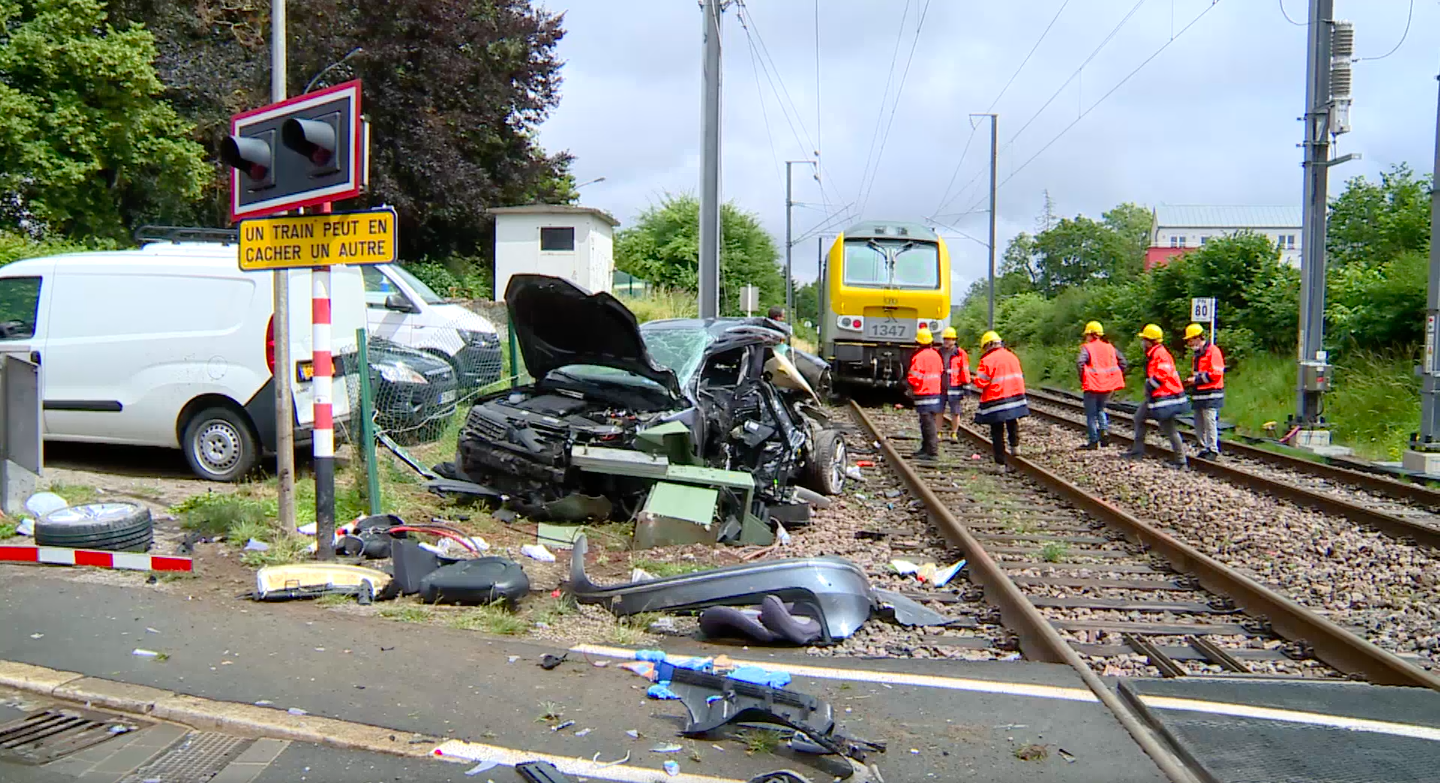 Screenshot of video showing the car crumpled after it crashed with the train. | Source: RTL Today
