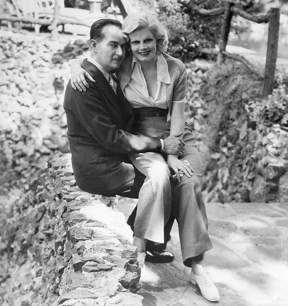 Paul Bern, noted producer, scenario writer and studio executive, whose suicide has shocked the country, and his bride, Jean Harlow, famous for her platinum hair. This picture was taken shortly after their marriage. | Source: Getty Images