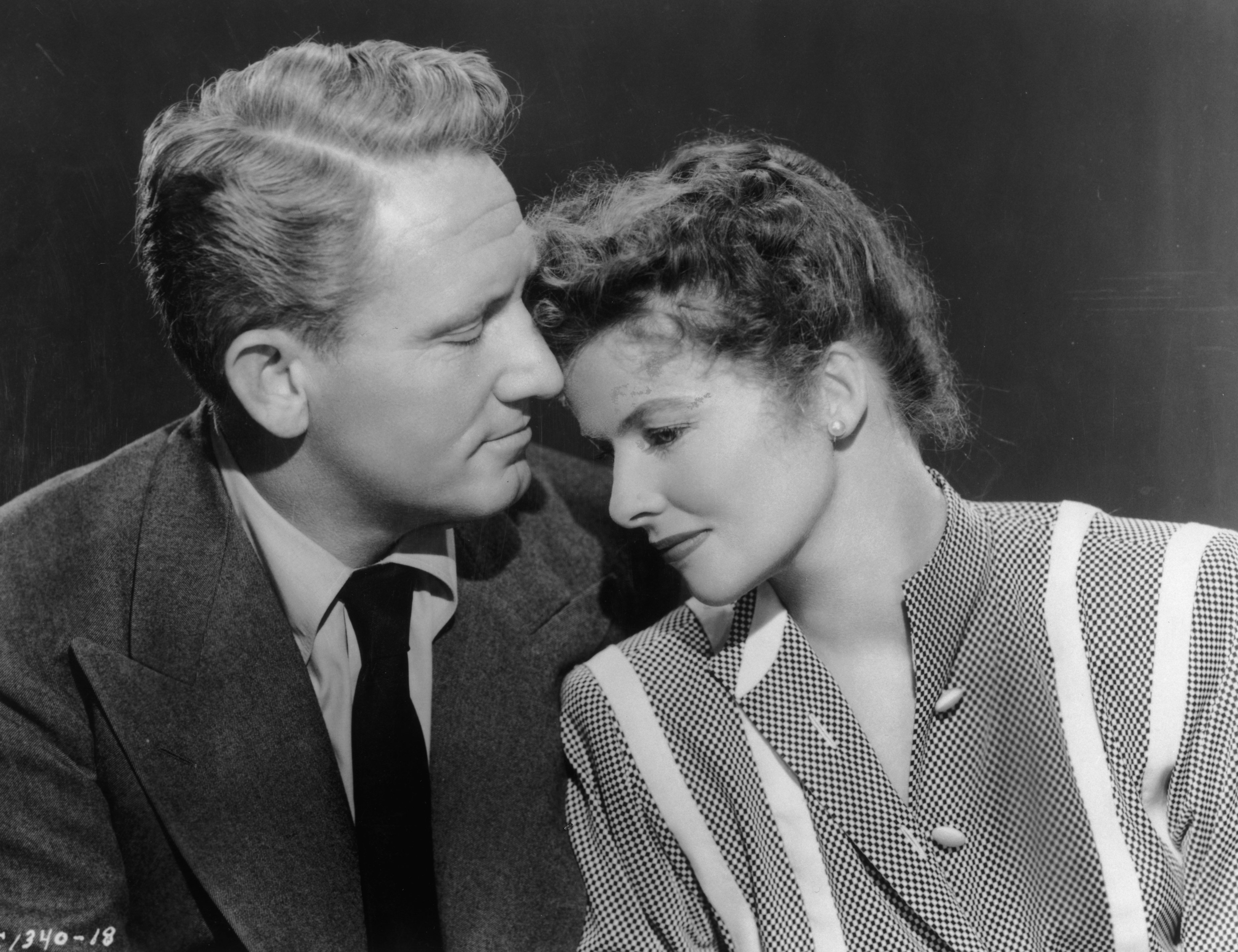 American actors Spencer Tracy (1900 - 1967) and Katharine Hepburn (1907 - 2003) comfort one another in a still from director Harold S Bucquet's film, 'Without Love'.   Source: Getty Images