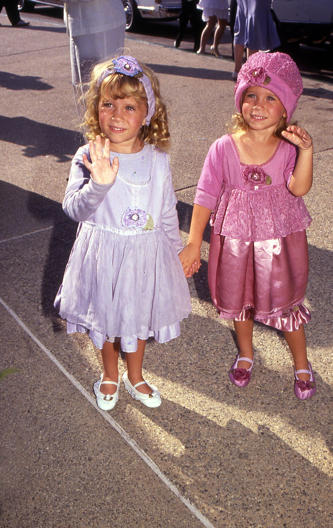 circa 1990 - Mary Kate and Ashley Olsen arriving at a celebrity event | Shutterstock