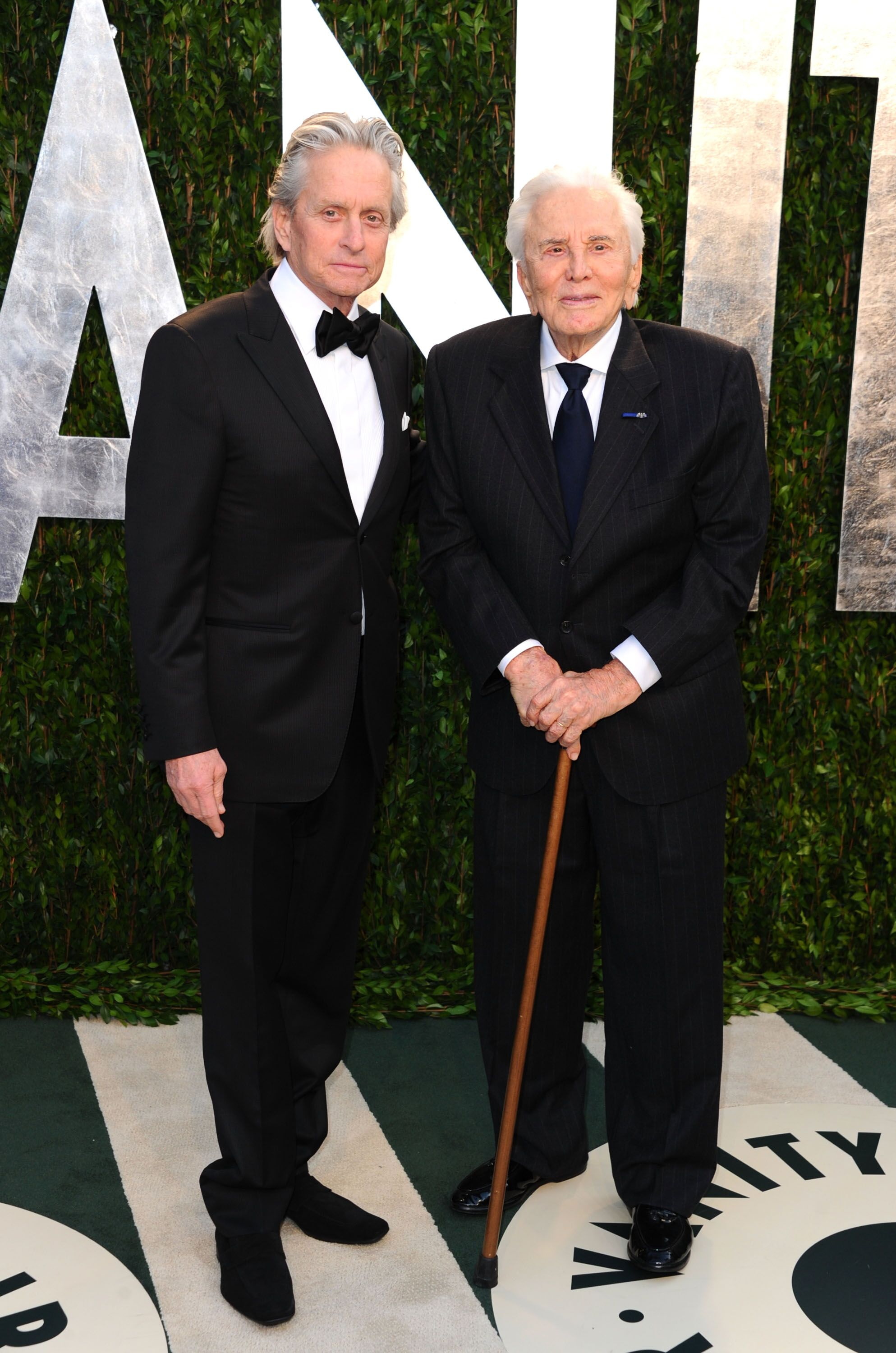 Michael Douglas and Kirk Douglas arrive at the 2012 Vanity Fair Oscar Party. | Source: Getty Images