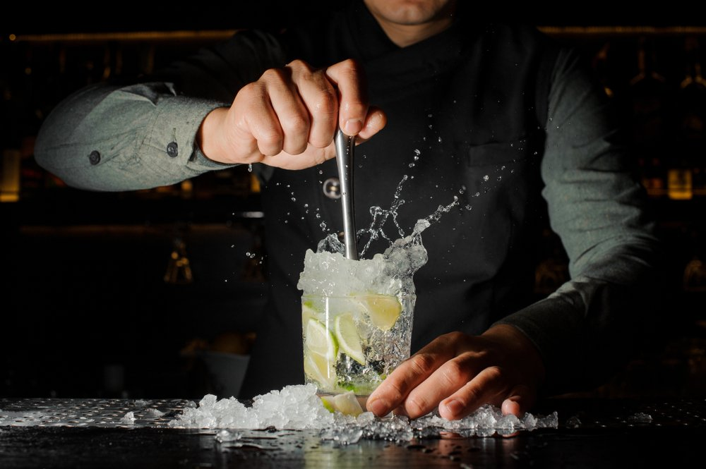 A photo of a bartender mixing drinks.   Photo: Shutterstock