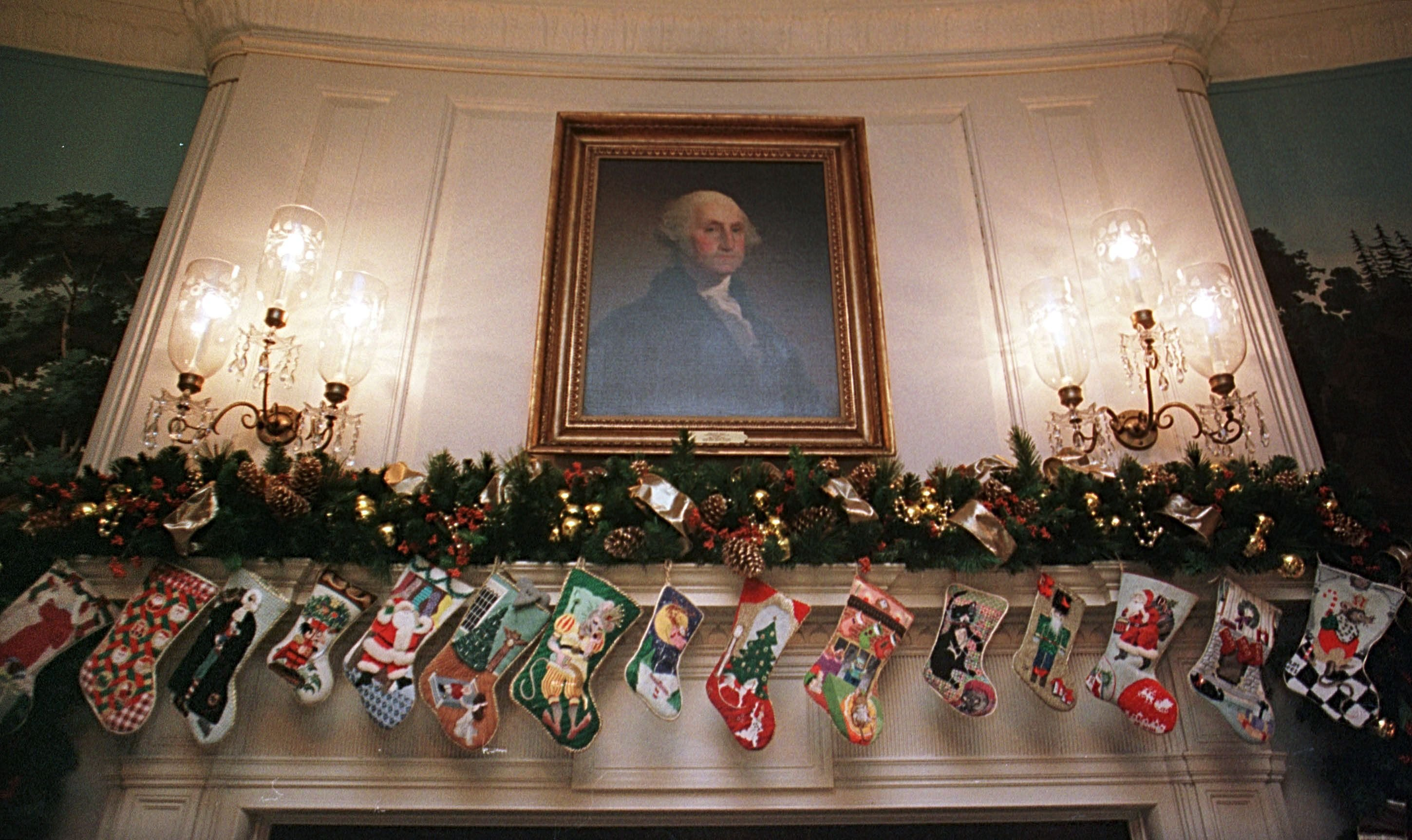 Christmas socks hang on the fireplace below a portrait of President George Washington in the Diplomatic Reception Room of the White House December 4, 2000 in Washington DC.   Source: Getty Images