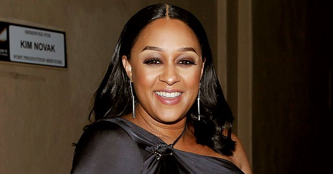 Tia Mowry Looks Stunning Flaunting Her Long Hair & Slim Figure in a Stylish Blouse & Jeans