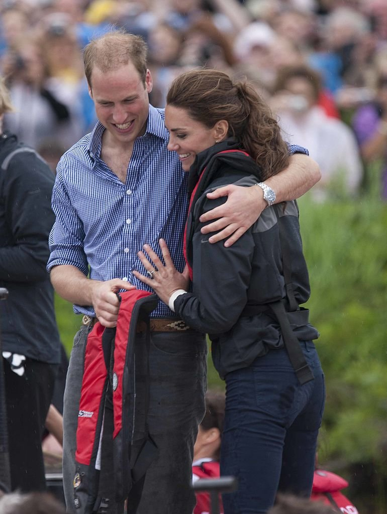 Prince William, Duke of Cambridge and Catherine, Duchess of Cambridge hug after taking part in a dragon boat race at Dalvay-by-the-sea on day 5 of the Royal Couple's North American Tour, July 4, 2011 | Photo: Getty Images