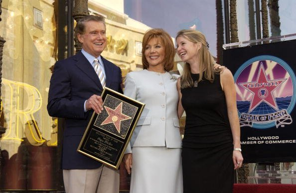 Talk show host Regis Philbin, his wife Joy and daughter JJ pose for a photograph after receiving a Star on the Hollywood Walk of Fame on April 10, 2003, in Hollywood, California. | Source: Getty Images