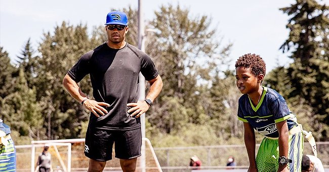 Russell Wilson Performs Stepfather Duties as He Teaches Future Jr How to Play Football in Pics