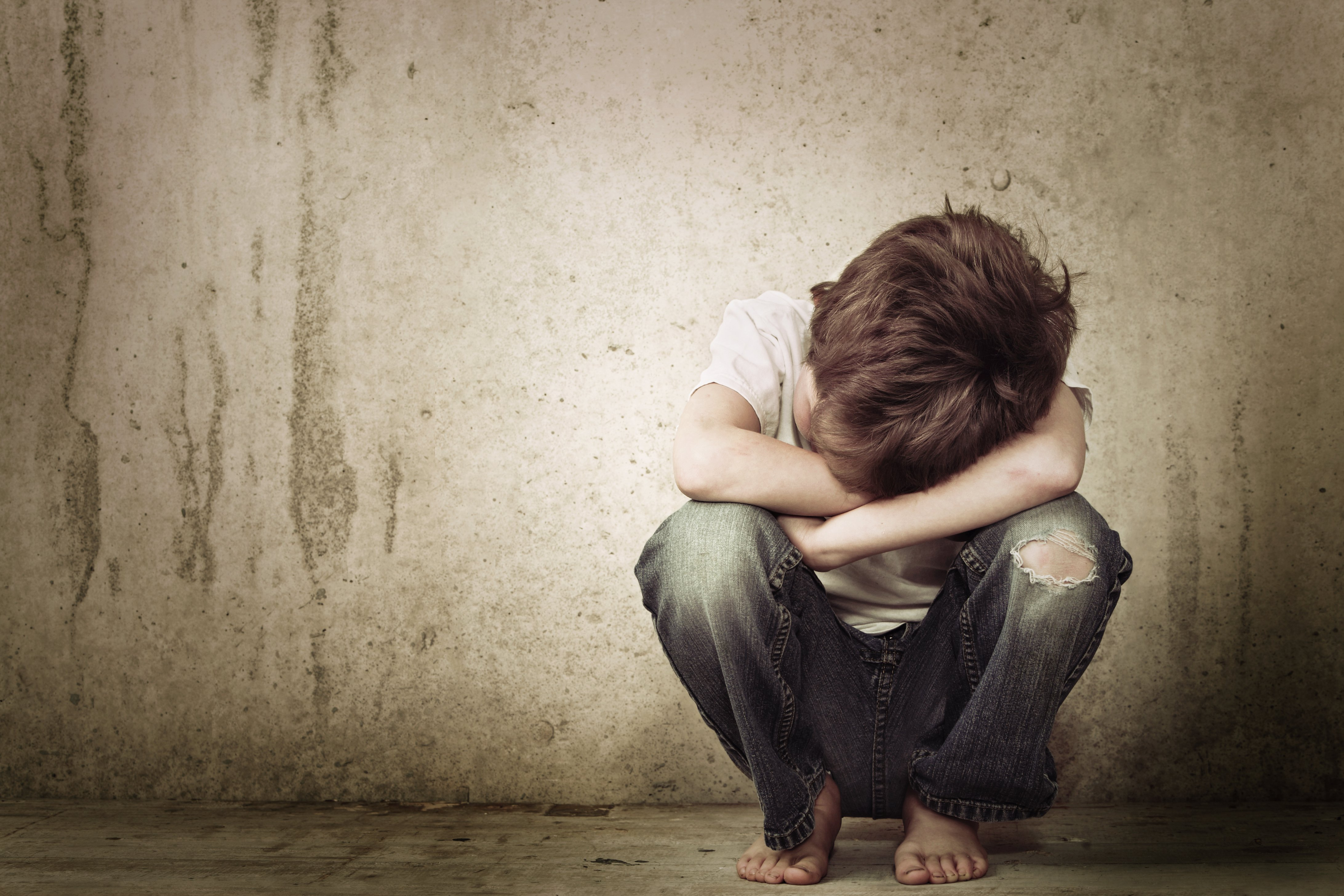 Sad boy crying in the corner. | Source: Shutterstock