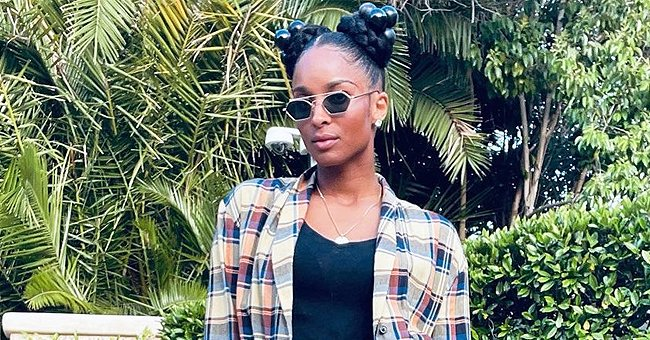 Ciara Grabs Attention Wearing Two Hair Buns in a Long Checkered Shirt & Heavy White Boots