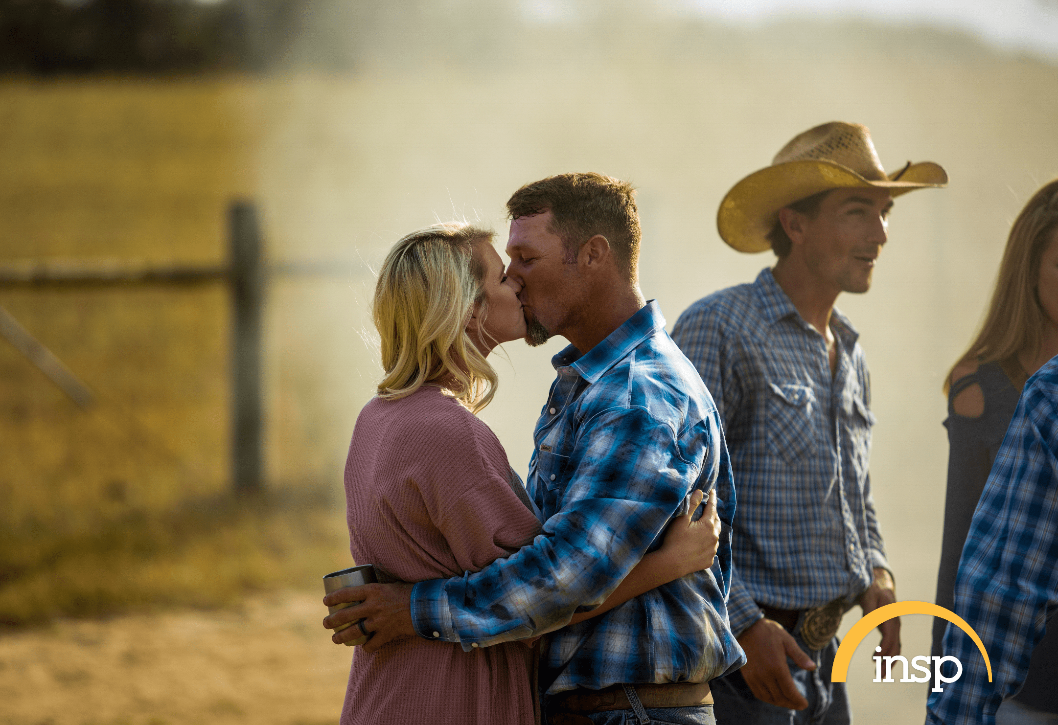 """The Cowboy Way"" star Bubba Thompson and his wife Kaley kiss in a photograph. 