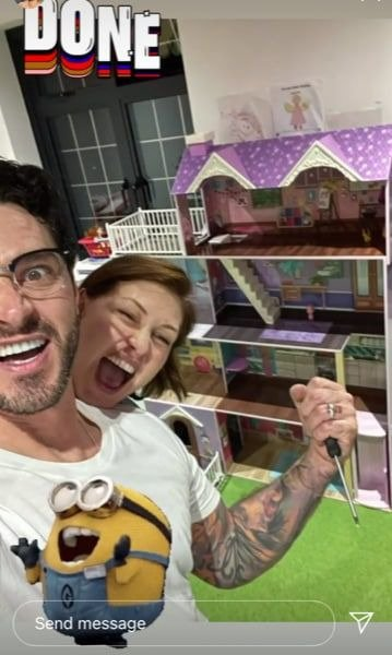 A picture of Emma Willis and her husband Matt rejoicing after the completion of their kids' doll house. | Photo: Instagram/Emmawillisofficial