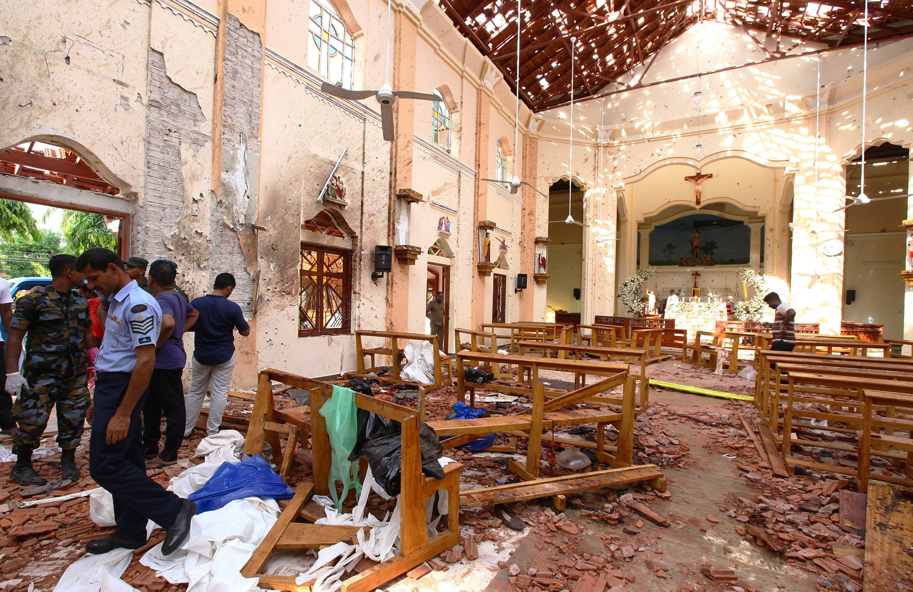 Sri Lankan officials inspect St. Sebastian's Church in Negombo, north of Colombo.   Photo: GettyImages