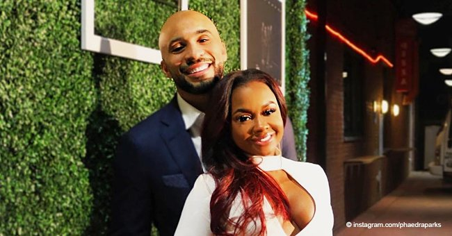 Phaedra Parks stuns in figure-hugging white dress while posing next to new boyfriend Tone Kapone
