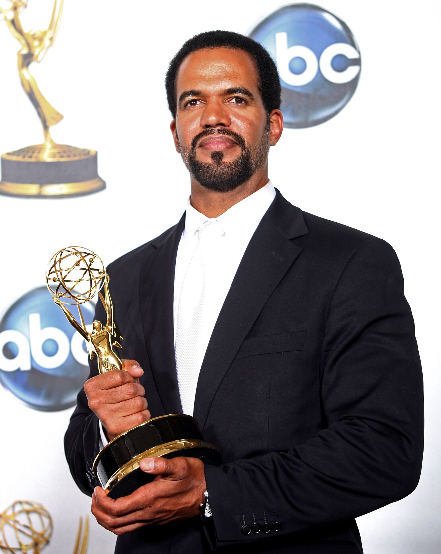 "Kristoff St. John poses with the Outstanding Supporting Actor In A Drama Series award for ""The Young and the Restless"" 