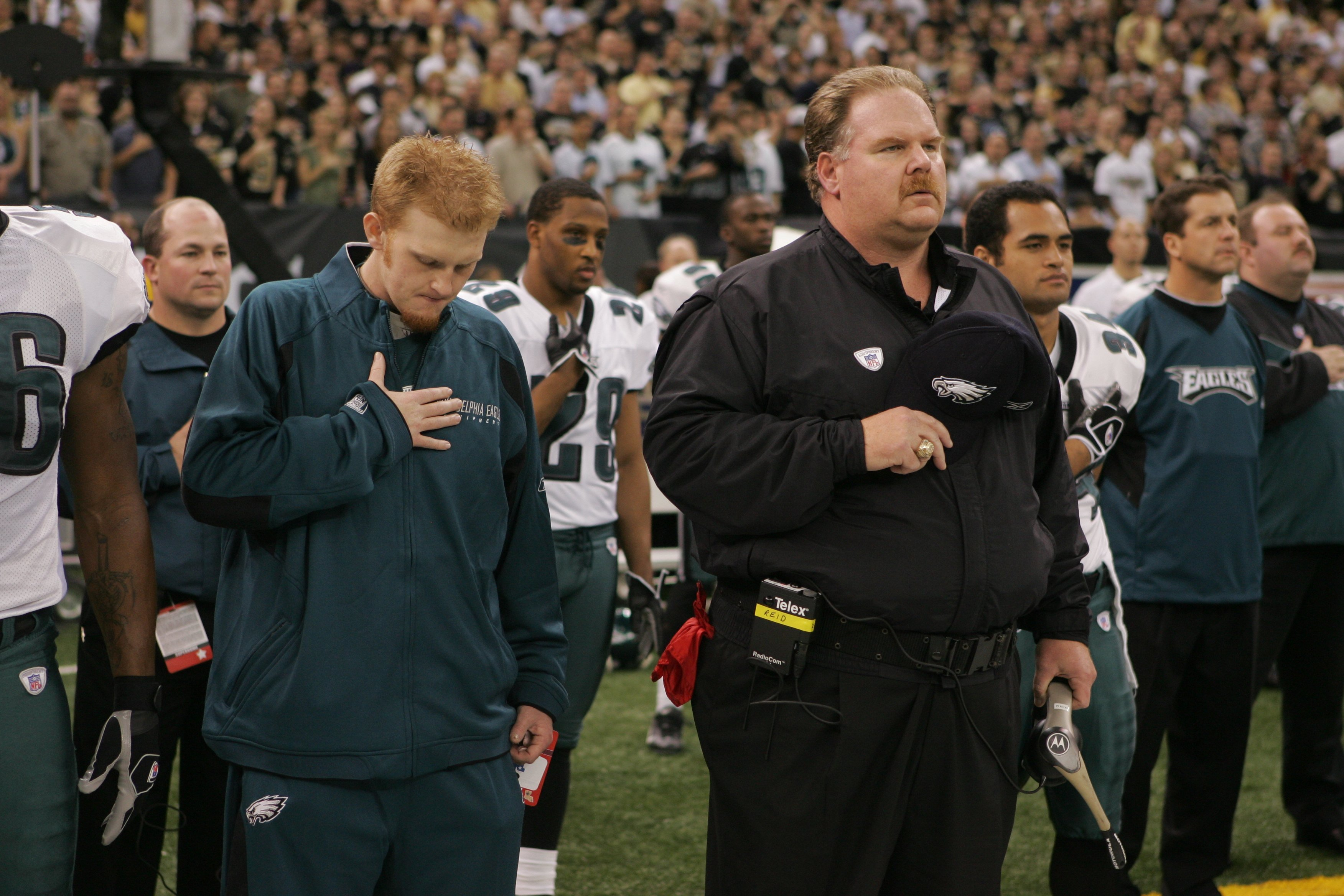 Father and son, Andy and Britt Reid during the national anthem at the Philadelphia Eagles vs New Orleans Saints game, January, 2007. | Photo: Getty Images.