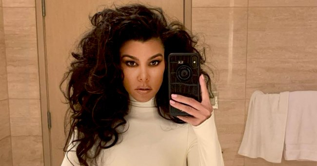 Kourtney Kardashian Pours Her Hourglass Figure Into a Strapless Skintight Latex Dress (Photo)