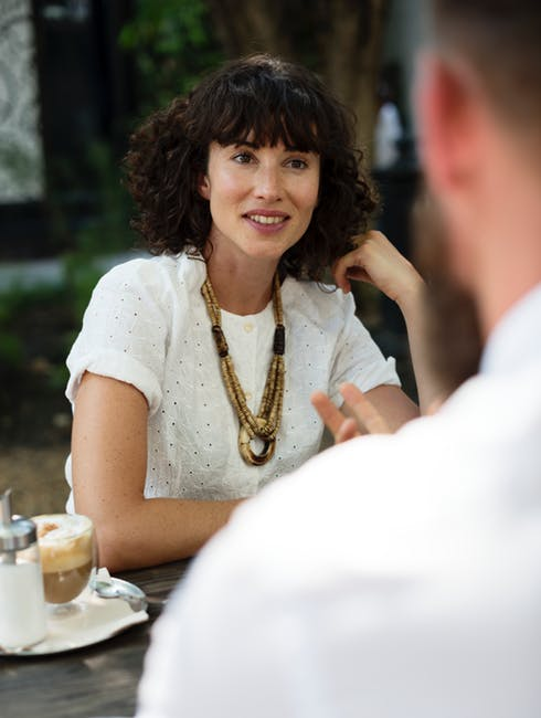 A woman staring at a man during a coffee date.   Source: Pexels