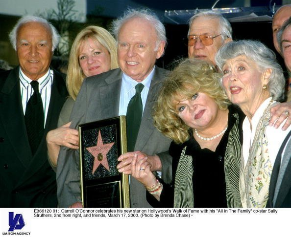 """Carroll O'Connor celebrates his new star on Hollywood's Walk of Fame with his """"All In The Family"""" co-star Sally Struthers, 2nd from right, and friends, March 17, 2000. 