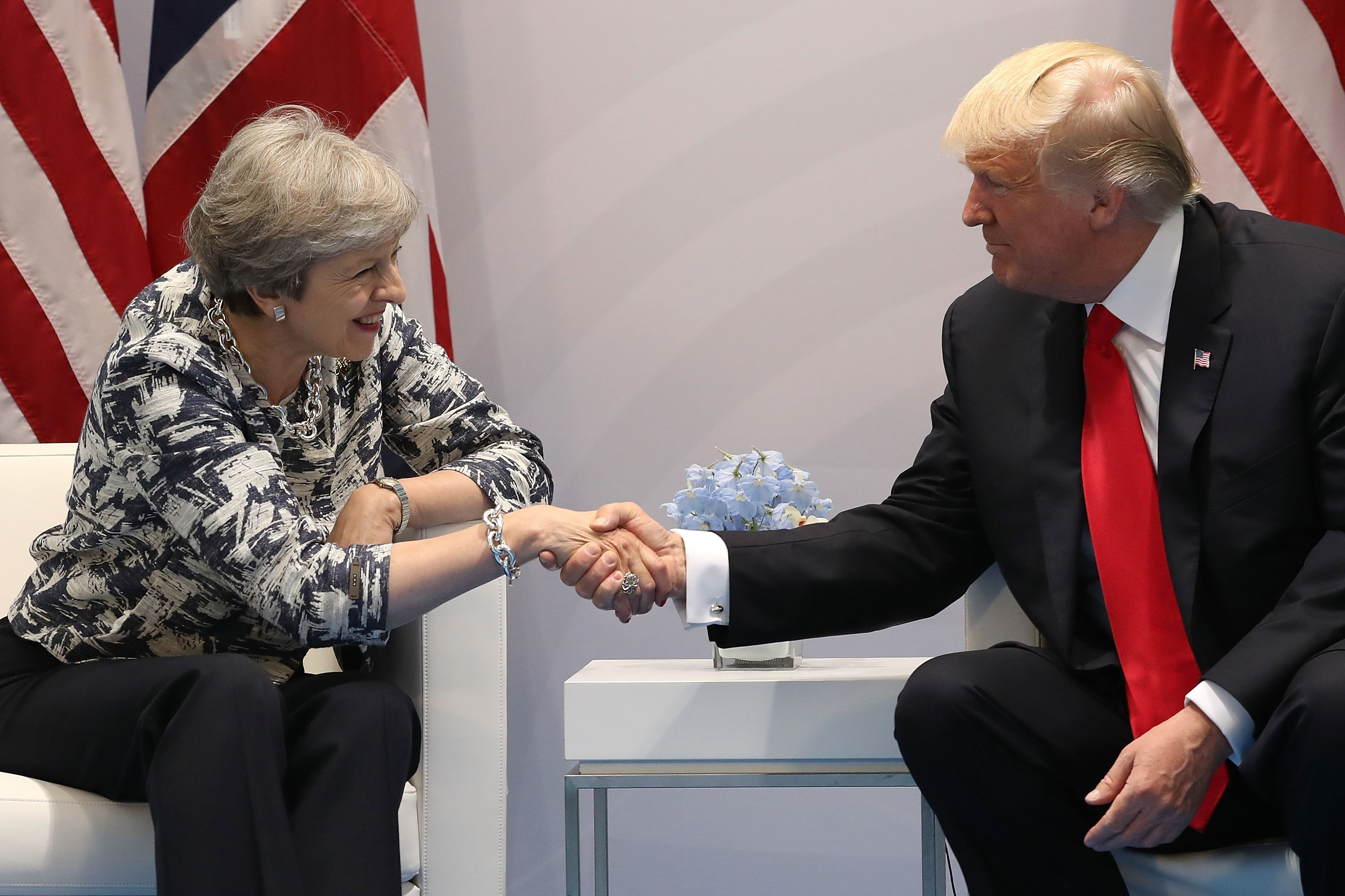 Theresa May greeting U.S Donald Trump at the 2017 G20 summit in Hamburg, Germany | Photo: Getty Images