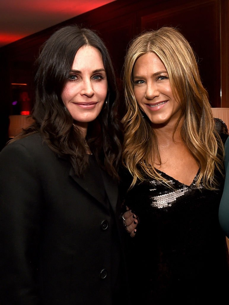 """Courteney Cox and Jennifer Aniston pose at the after party for the premiere of Netflix's """"Dumplin'"""" 