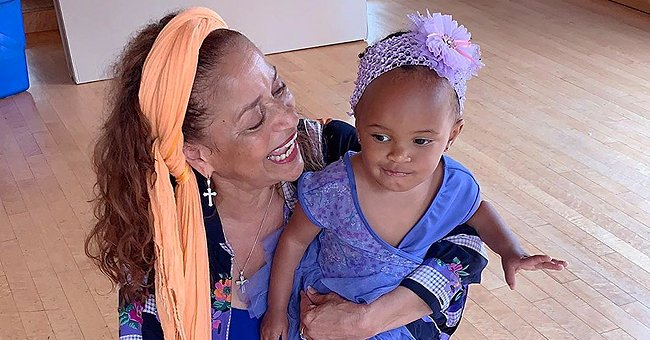 Debbie Allen Melts Hearts Posing with Her Adorable Granddaughter in a Dress & Ballet Slippers