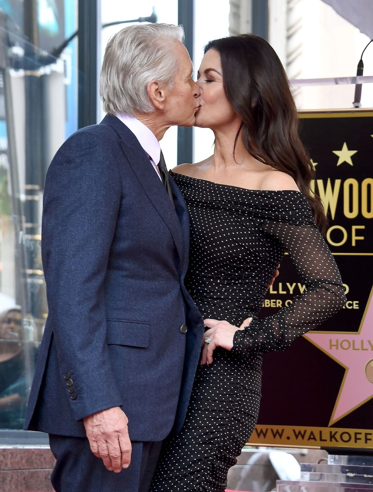 Michael Douglas and Catherine Zeta-Jones pose at the Michael Douglas Star On The Hollywood Walk Of Fame ceremony on November 6, 2018, in California | Photo: Gregg DeGuire/Getty Images