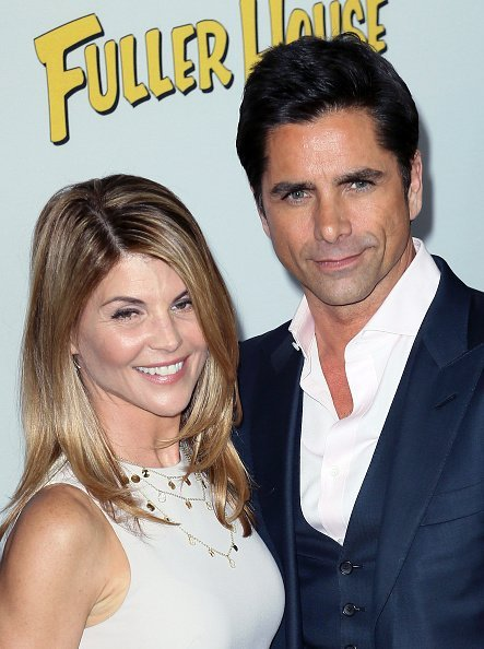 Lori Loughlin and John Stamos at Pacific Theatres at The Grove on February 16, 2016 in Los Angeles, California | Photo: Getty Images