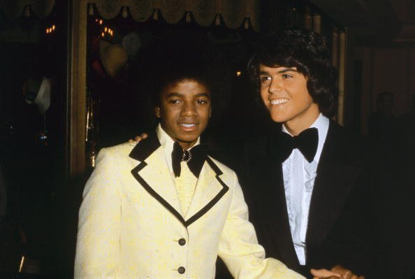 Michael Jackson (1958 - 2009) with Donny Osmond at the American Music Awards in Hollywood, 19th February 1974 | Photo: Getty Images