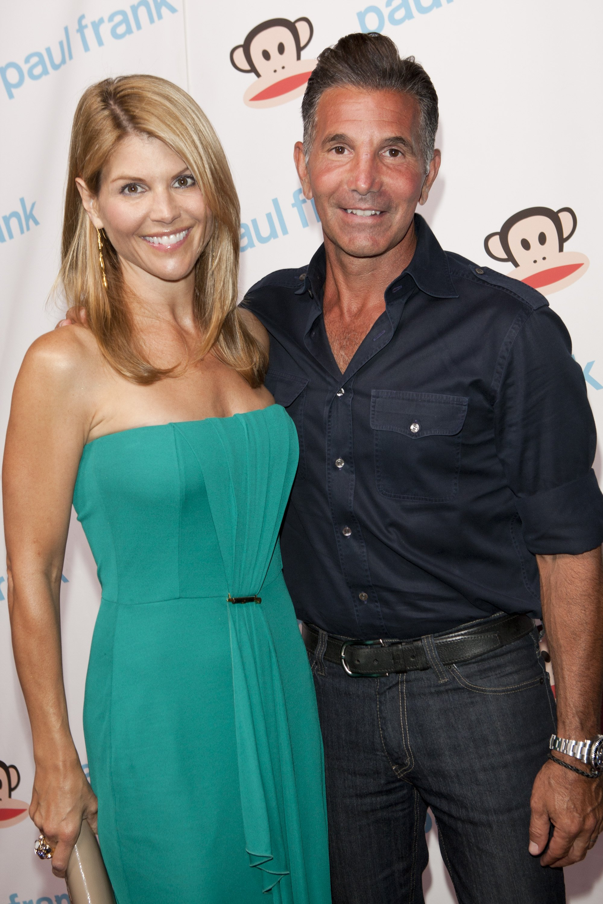 Lori Loughlin and husband Mossimo Giannulli attending Paul Frank's celebration of Fashion's Night Out at ADBD Gallery | Photo: Getty Images