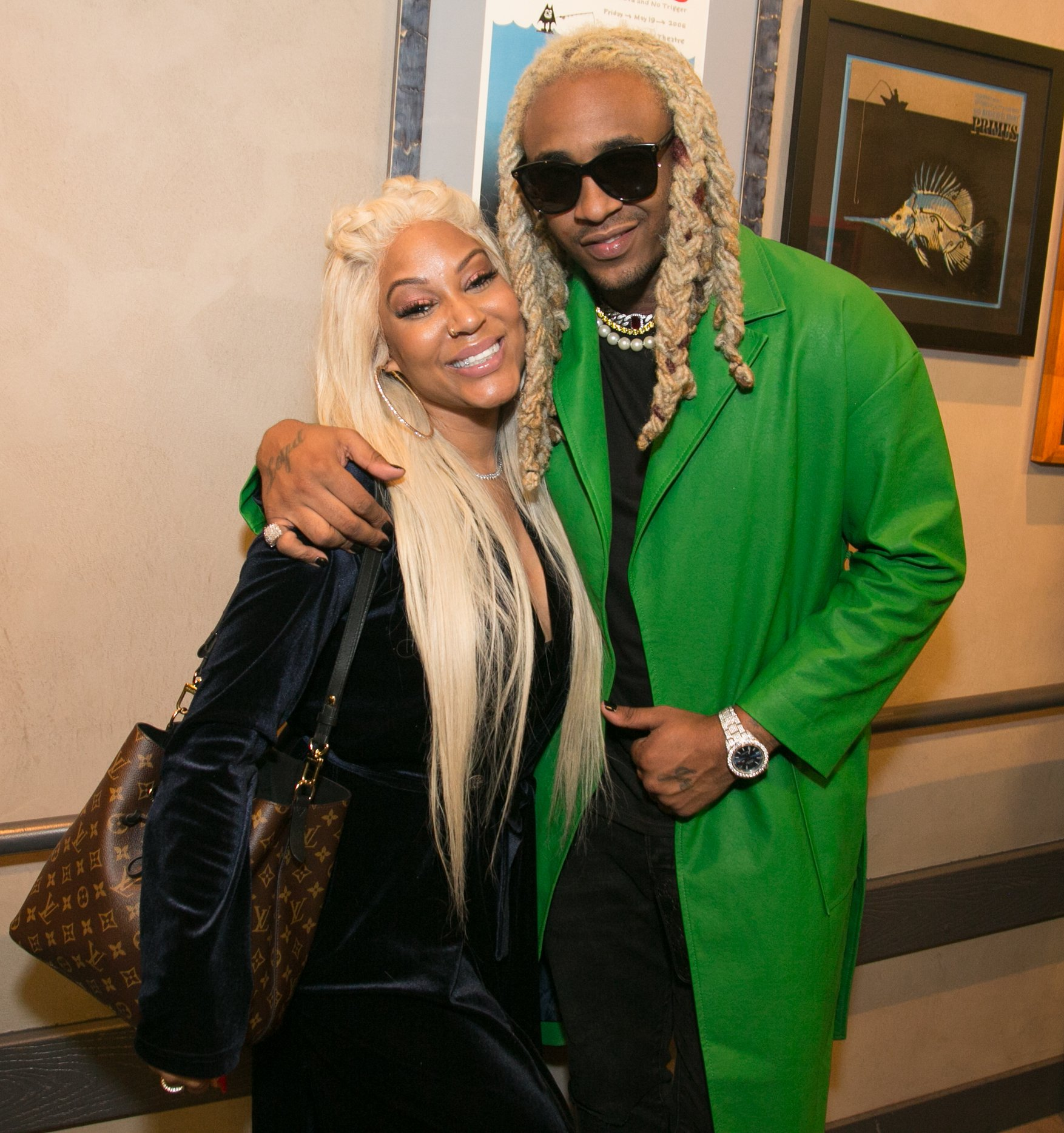 Lyrica Anderson and Floyd Bentley aka A1 watch Ty Dolla $ign in concert at The Novo on April 12, 2018 | Photo: Getty Images