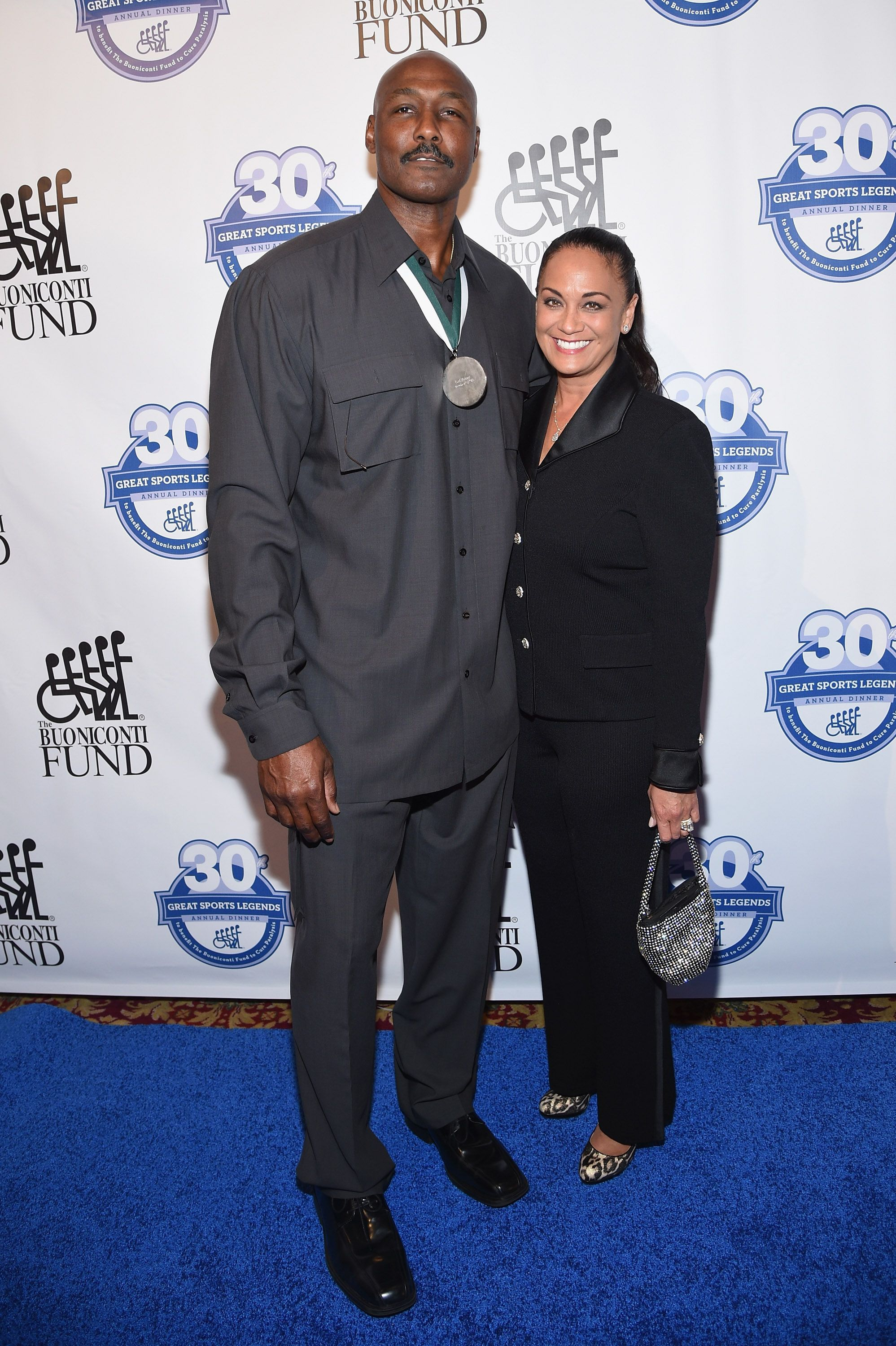 Karl Malone and his wife Kay Kinsey Malone attend the 30th Annual Great Sports Legends Dinner to benefit The Buoniconti Fund to Cure Paralysis at The Waldorf Astoria on October 6, 2015 in New York City. | Source: Getty Images