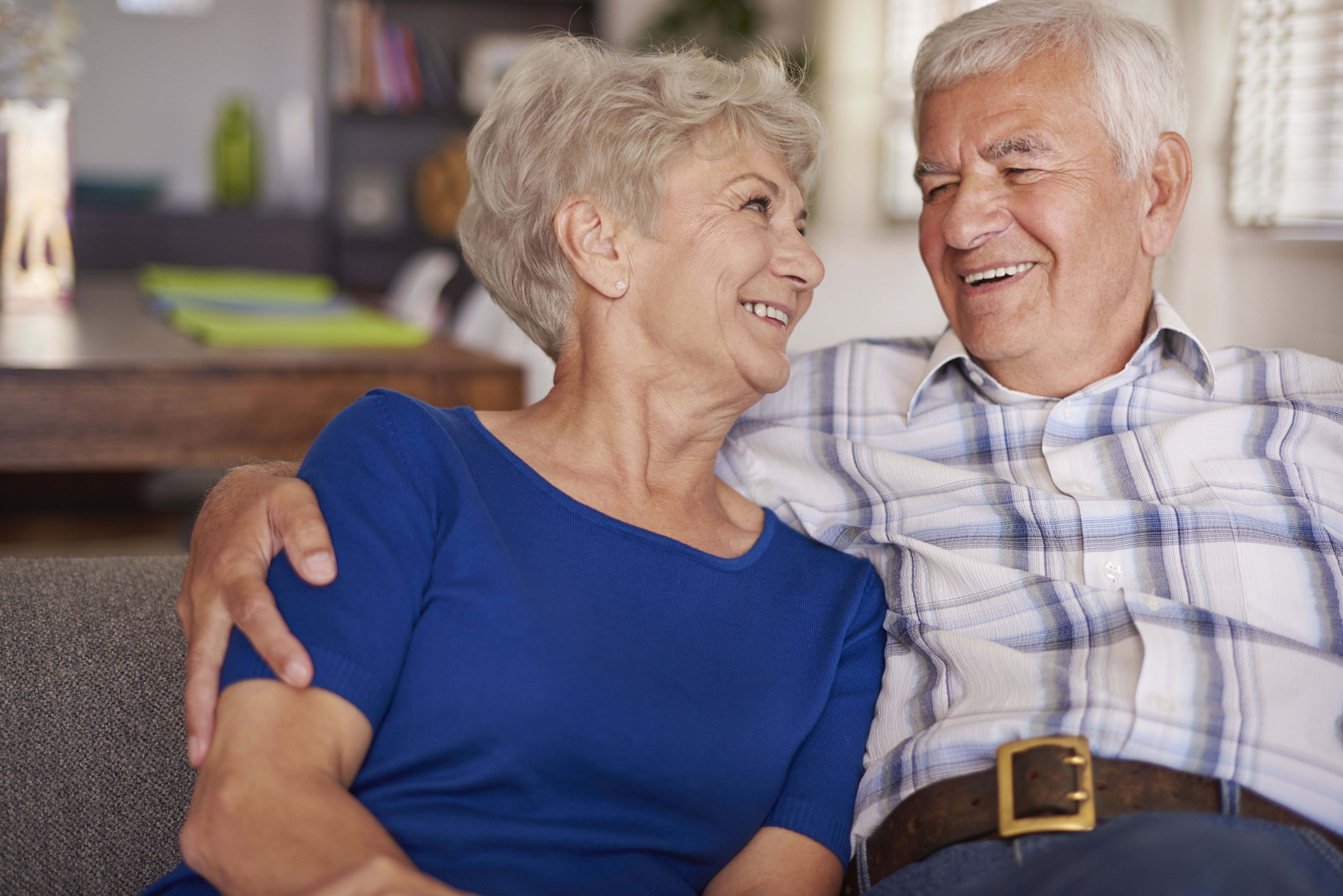 An elderly couple looking at each other while smiling. | Source: Shutterstock